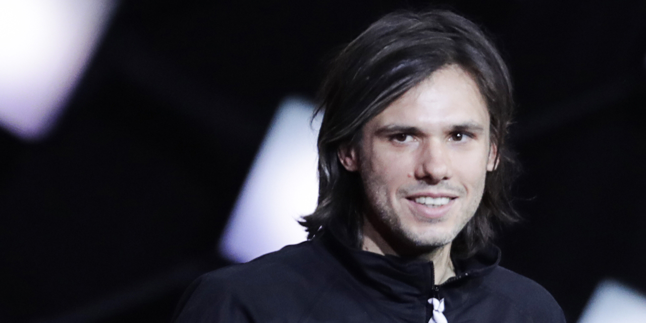 French rapper Aurelien Cotentin aka Orelsan celebrates after after receiving the best male artist award during the 33rd Victoires de la Musique, the annual French music awards ceremony, on February 9, 2018 at the Seine Musicale concert hall in Boulogne-Billancourt, on the outskirts of Paris. / AFP PHOTO / Thomas SAMSON